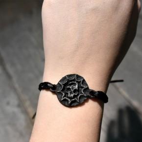 Bracelet Krankheit Logo